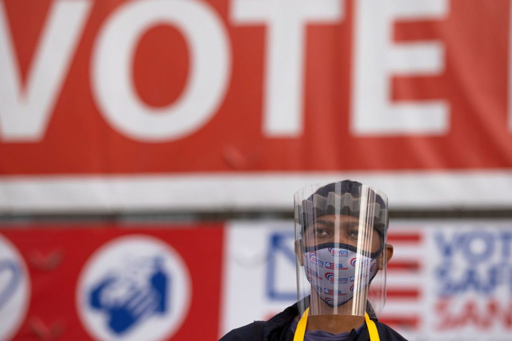 Election worker Tommy Rose wears protective gear as he collects mail-in ballots at the Registrar of Voters on the day of the U.S. Presidential election in San Diego, California, U.S., November 3, 2020. REUTERS/Mike Blake