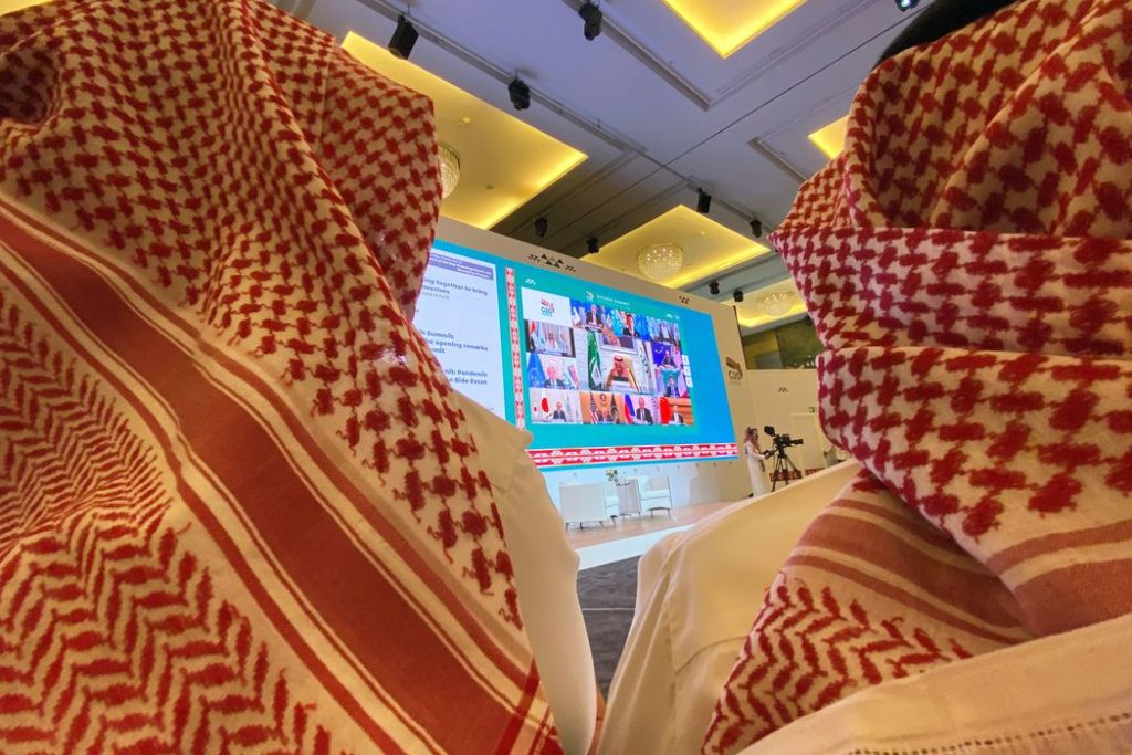 Journalists watch Saudi King Salman bin Abdulaziz's virtual speech live at the media centre during an opening session of the 15th annual G20 Leaders' Summit in Riyadh, Saudi Arabia November 21, 2020. REUTERS/Nael Shyoukhi