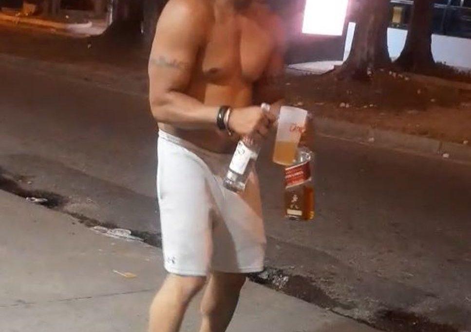 Bombeiro que atropelou ciclista no Recreio aparece em vídeo, gravado horas antes, com garrafas de vodca e uísque/Reprodução