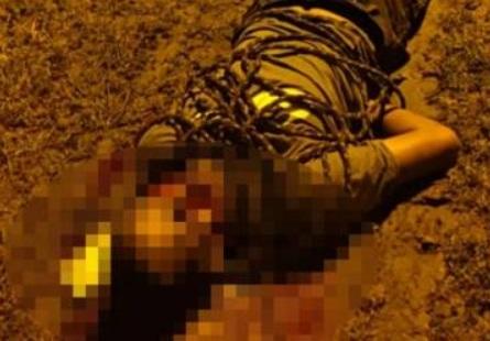 O corpo estava amarrada com uma corda e tinha marcas de agressão e tiros/Reprodução
